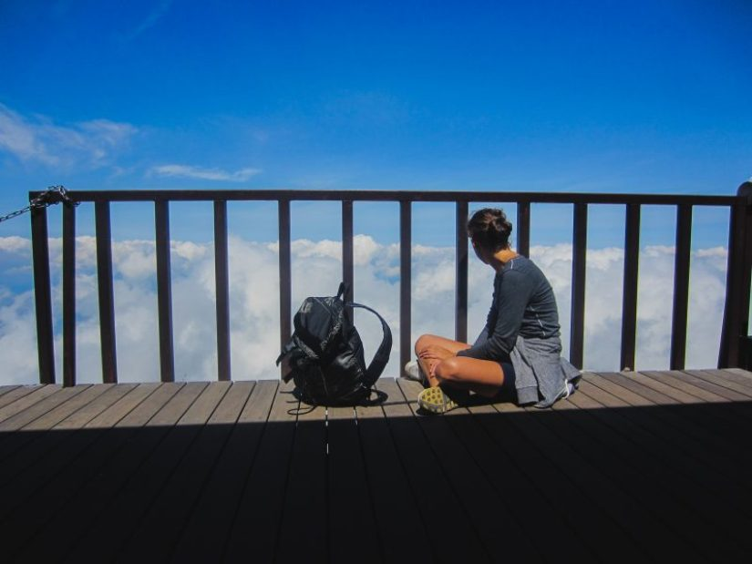 sitting above the clouds on mount fuji