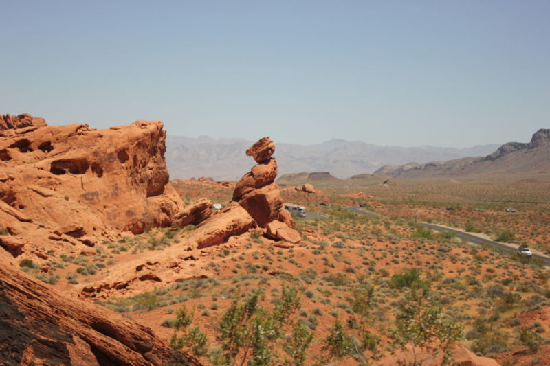 Photo of Balanced Rock, a rock balancing on another rock in the valley of fire red rock landscape