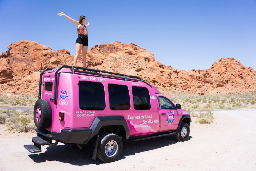 Allison standing on top of a pink jeep in the valley of fire of las vegas