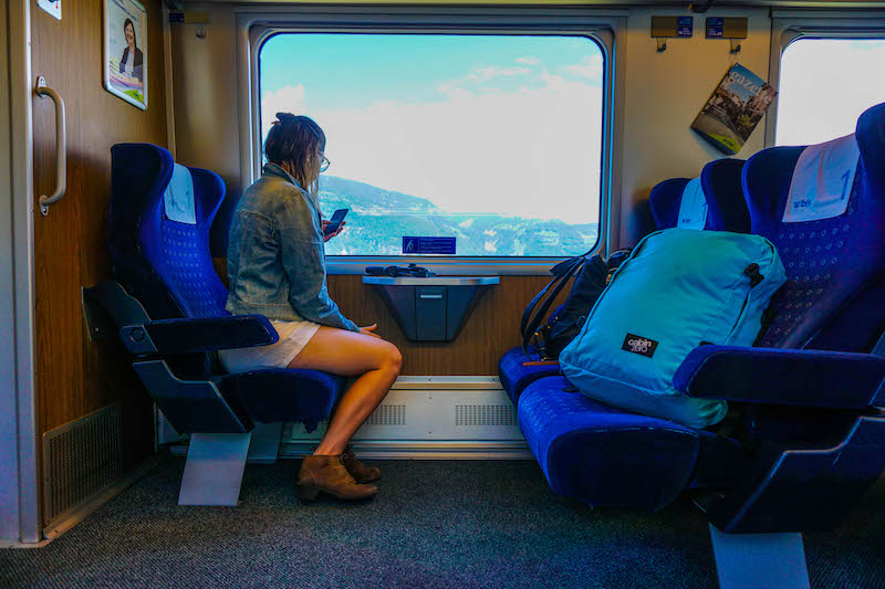 [woman on a train] - best places to visit in Switzerland