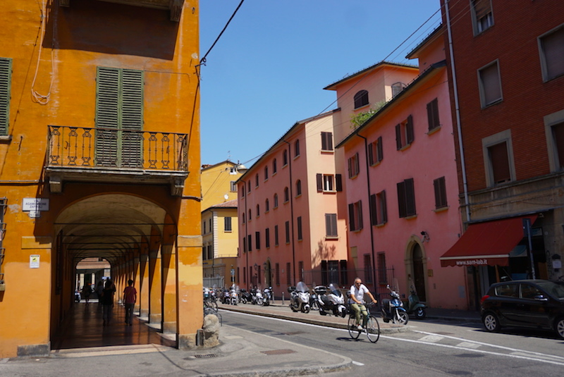Bologna porticos and buildings and bicyclist