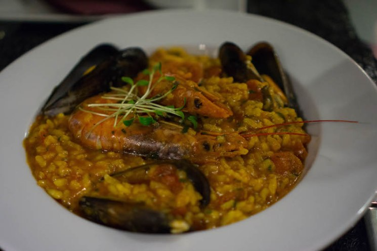 a dish of shrimp and mussel risotto