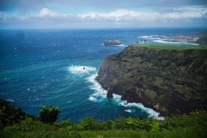 view of the rugged coastline of sao miguel from one of the many miradouros on the island, a must on any sao miguel itinerary