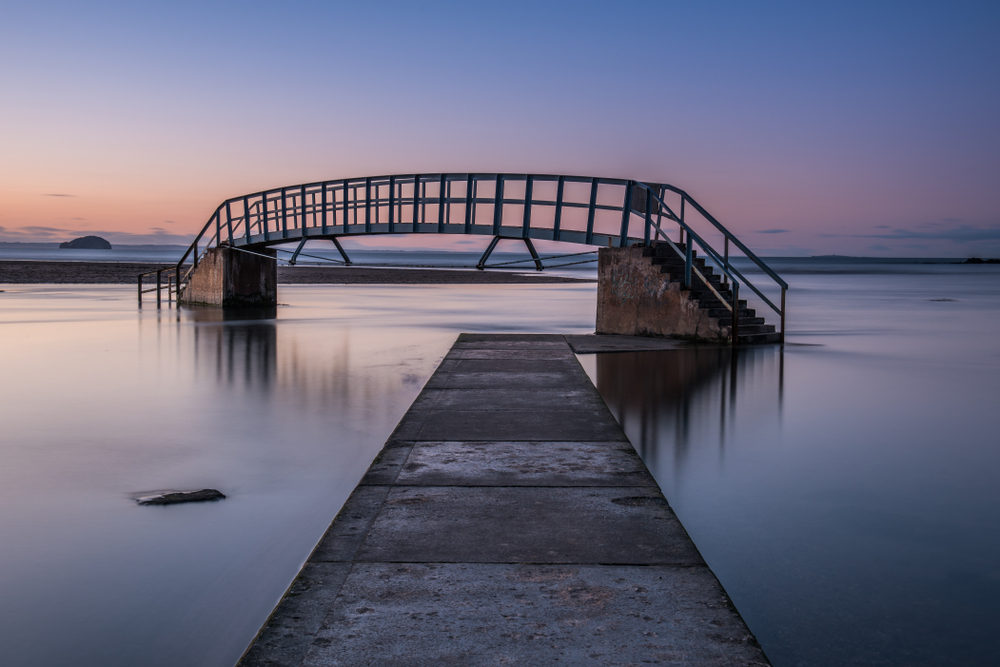 Sunset at a bridge with both entrances covered in water