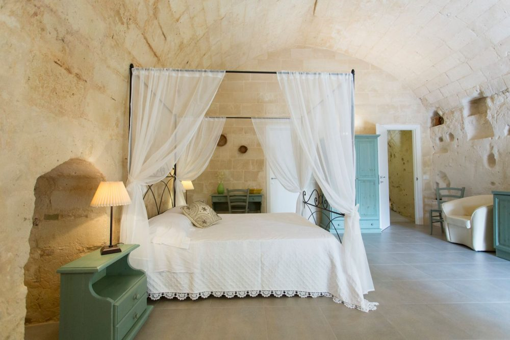 Cave hotel with canopy bed