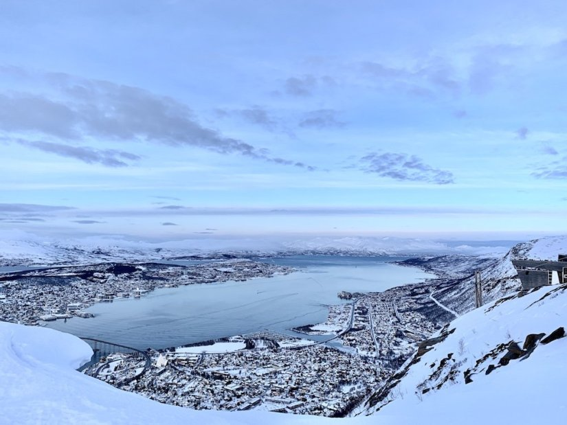 Views from over the cable car up to Fjellheisen looking over the fjord of Tromso and the city just after sunset