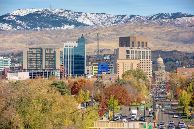 View of downtown Boise with lots of buildings and a busy road in the autumn as the colors change on the fall trees,