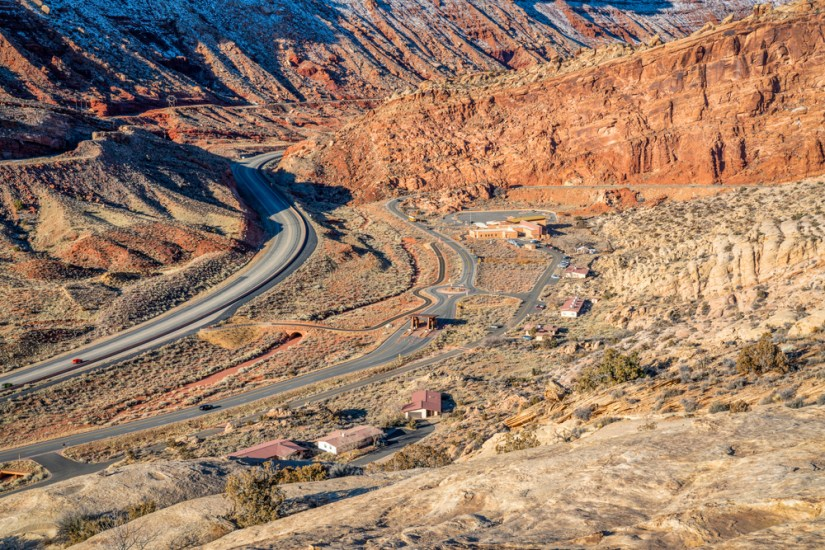 view from the moab fault overlook viewpoint over the red rock landscape of this beautiful utah national park.