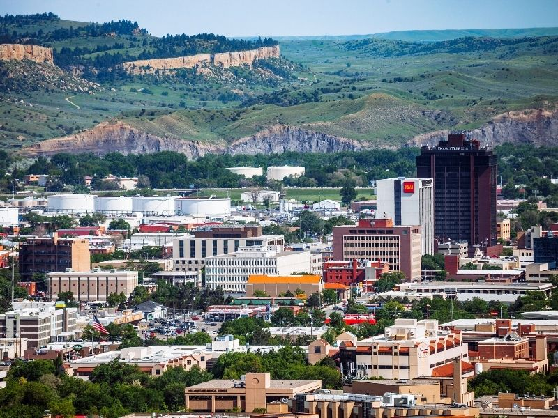 The landscape of downtown Billings, Montana: buildings against greenery and plateaus