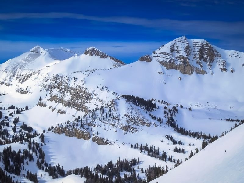 A close up view of peaks in the mountains of Jackson Wyoming in winter with snow