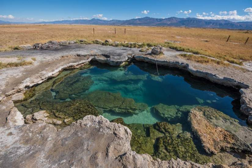 Brilliant turquoise hot spring in the middle of nowhere in Utah.