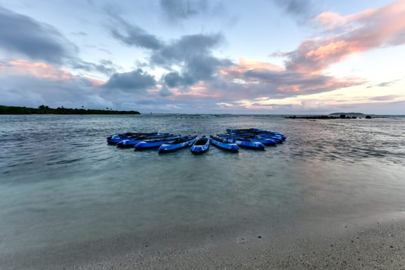 kayaks at sunset awaiting guests to go on a bio bay tour of the lagoon in fajardo puerto rico