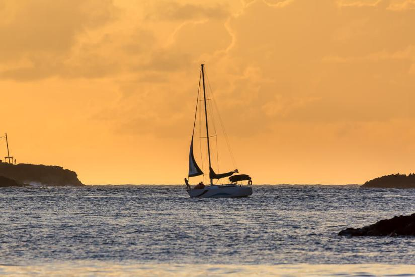 Silhouette of a sailing boat at sunset in the Caribbean in San Juan, Puerto Rico