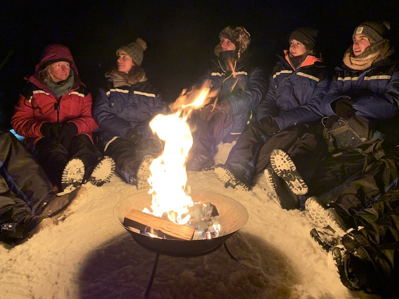 People sitting around the fire