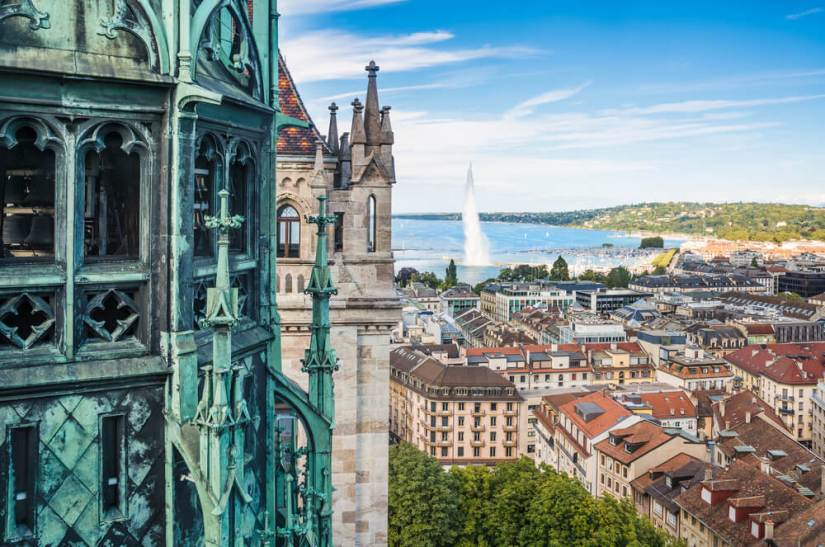 View of Geneva from the height of the Cathedral of Saint-Pierre, Switzerland, with the famous Geneva fountain visible in the distance