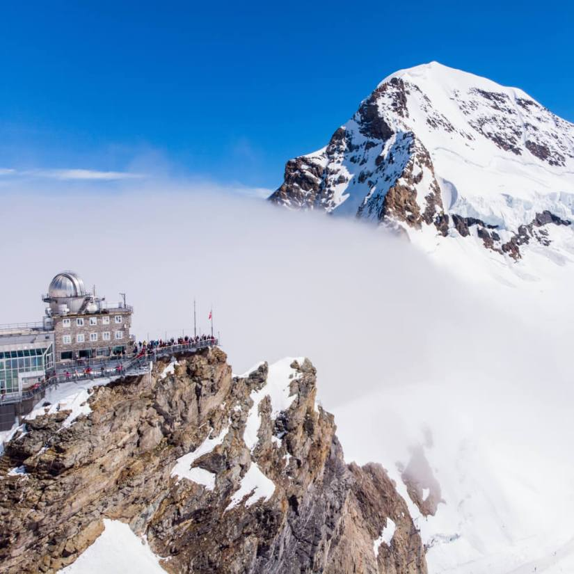 The station at the Top of Europe, Jungfraujoch, on a cloudy day with a view of a mountain in the distance
