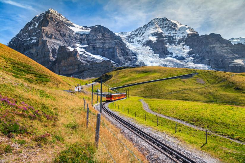 Famous electric red tourist train coming down from the Jungfraujoch station (The Top of Europe) in Kleine Scheidegg.