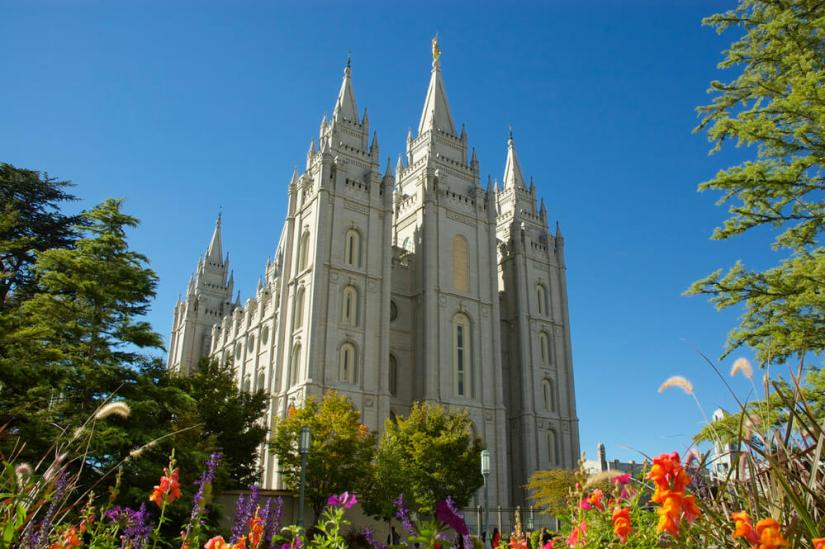 The giant Mormon Temple in Salt Lake City with flowers in the foreground