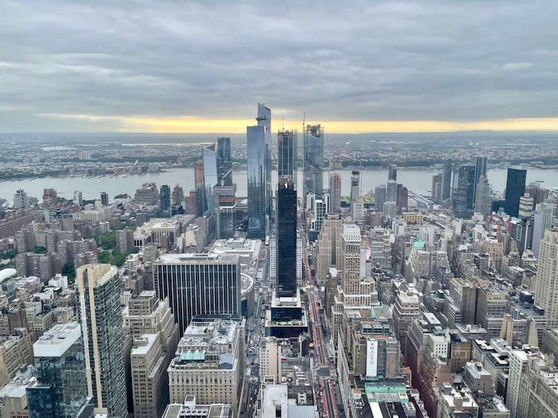 A view from the Empire State Building at sunset, in the distance you can see the observation tower of The Edge in Hudson Yards!