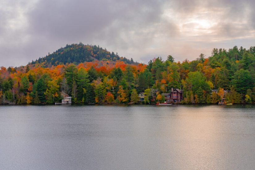 lake placid with orange trees in the fall