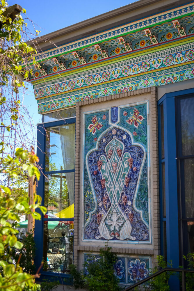 intricate detailing on the dushanbe tea house in boulder with teal and blue and pink detail