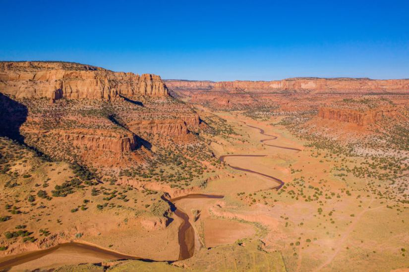 Canyon de Chelley red rock landscape with a river snaking below it