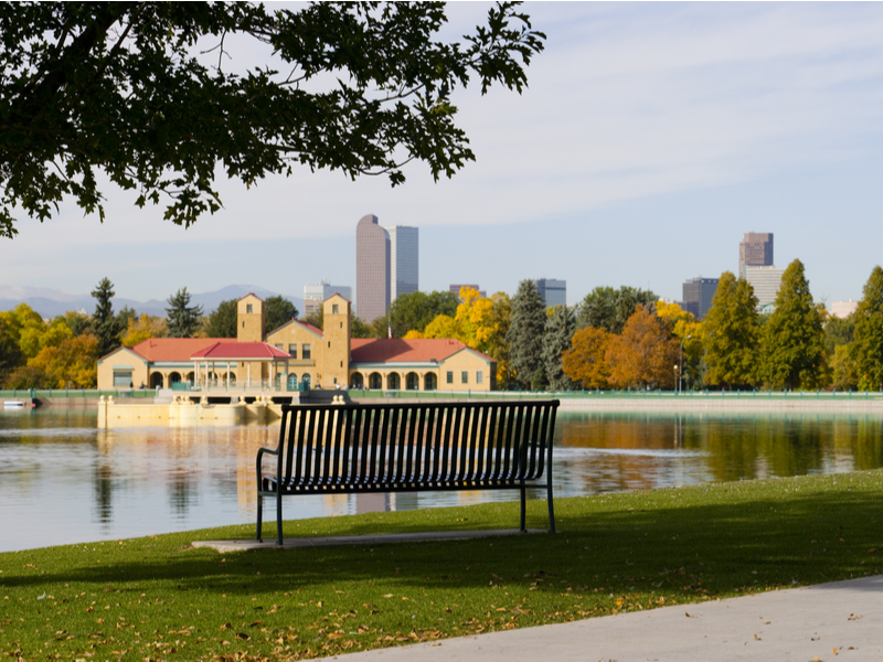 Bench looking over the lake and pretty structures downtown in Denver