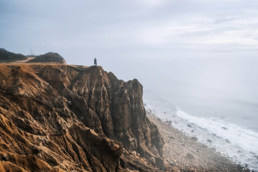 Person standing at the cliff edge in Montauk NY