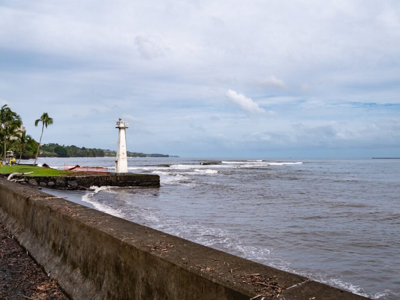 white lighthouse on a cloudy day at a famous place in hilo