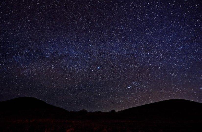 Purple night sky studded with millions of stars on Mauna Kea