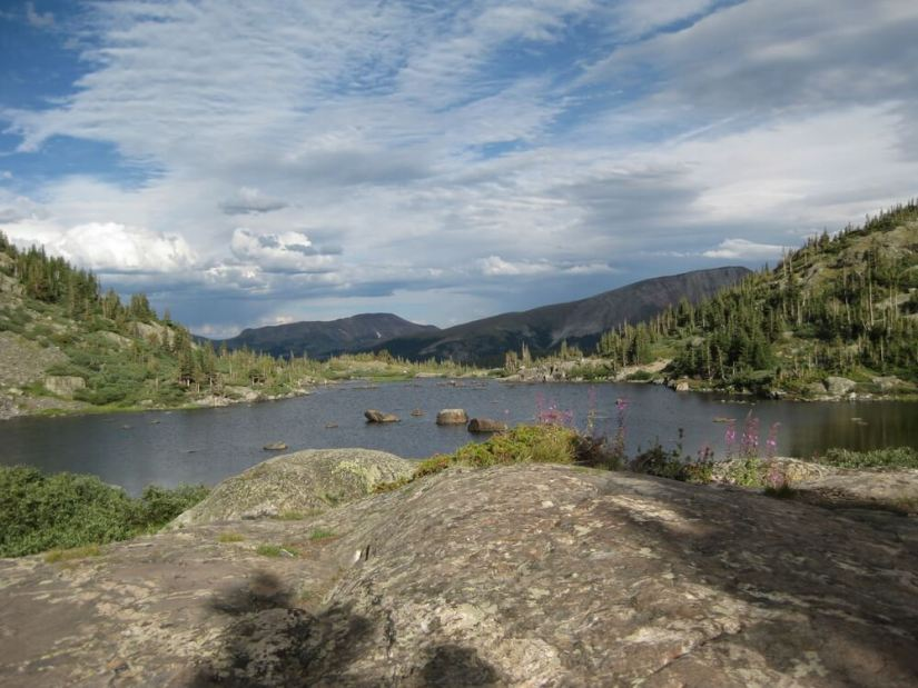 Mohawk Lake is surrounded by lichen covered rocks. It is a popular hiking trail in Breckenridge Colorado