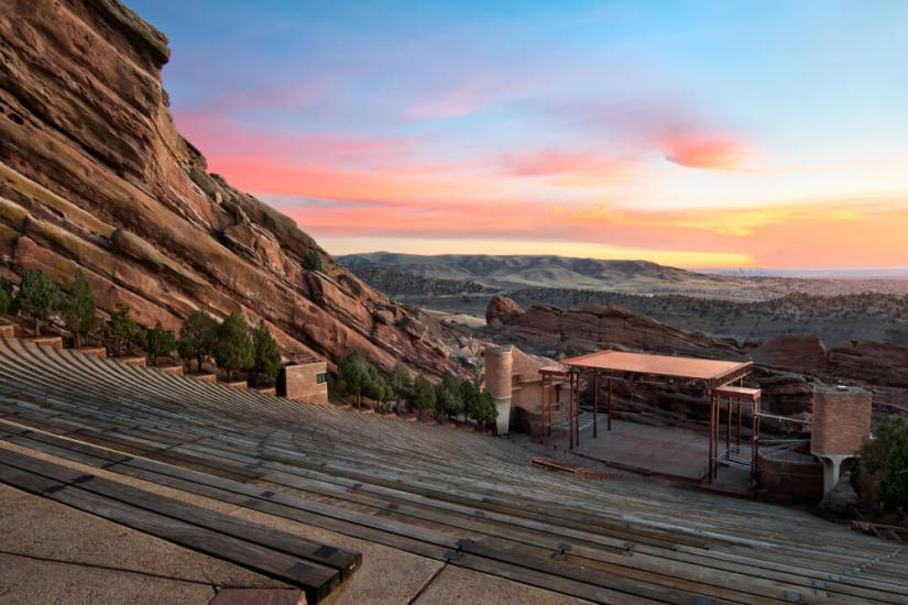 The colorful red rocks amphitheater as seen at sunrise with a colorful sky