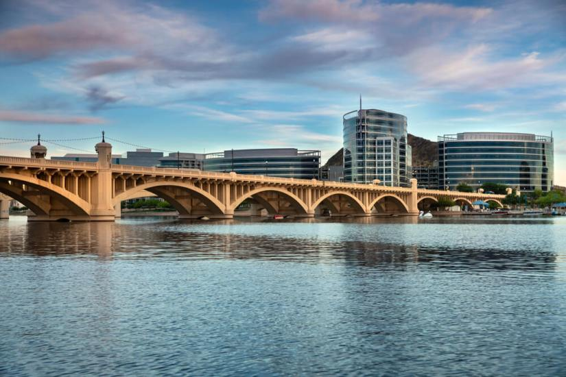 Lake in Tempe with bridge and skyline