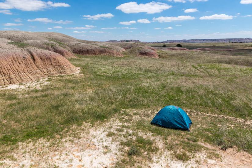 A blue tent out in the wilderness of Badlands National Park backcountry