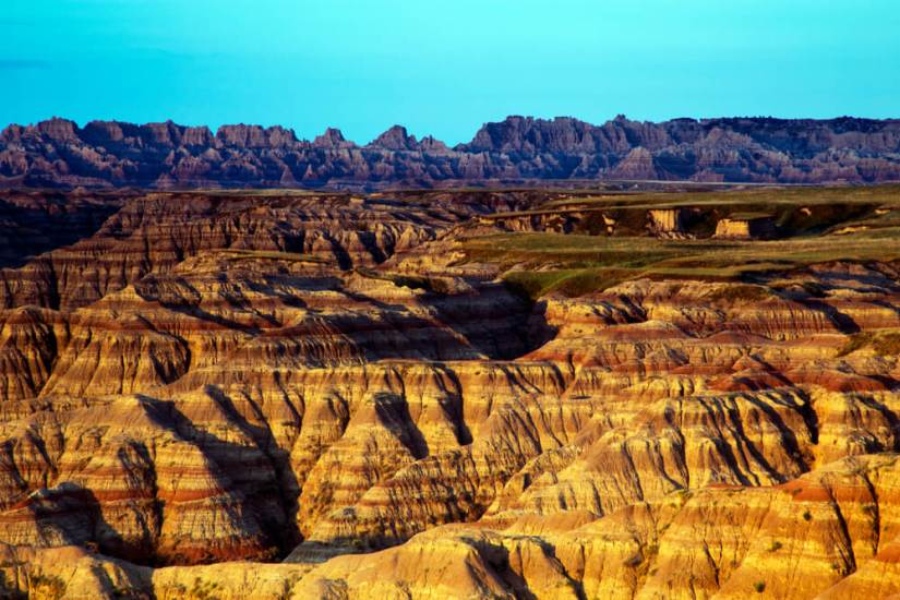 Striations in the rock formations of the pinnacles in the Badlands national park of south dakota at sunset