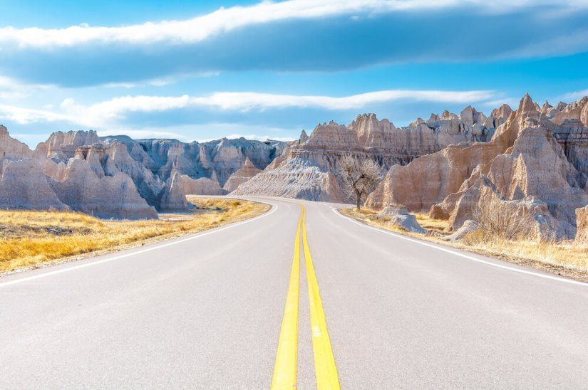 Taking the scenic Badlands Loop, driving on an empty road in the Badlands in South Dakota