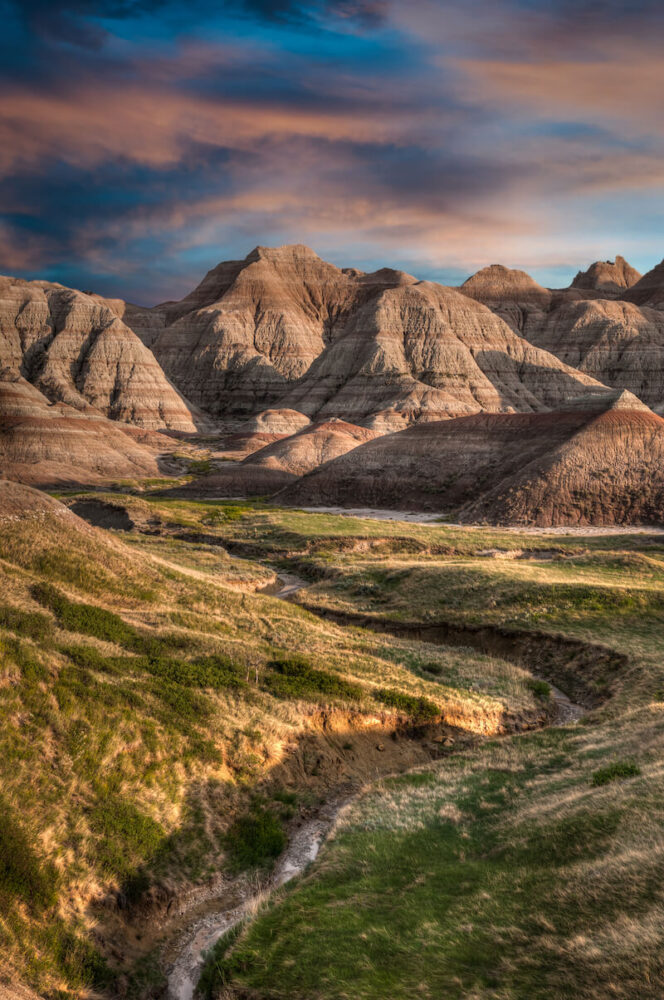 Small hills in the Badlands National Park at sunset with light falling on the rock formations