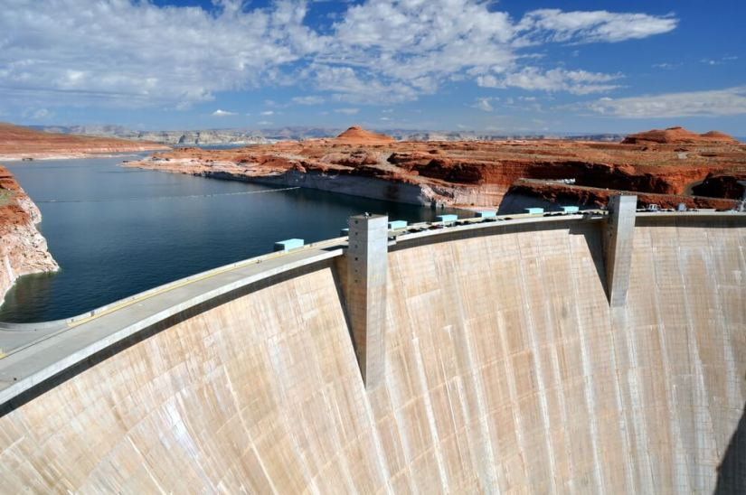 the giant dam at the hoover dam, holding in water from lake mead, near the border of arizona and nevada