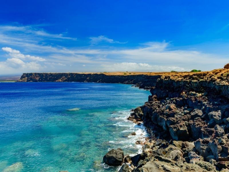 the ka lae south point coastline, the southernmost part of the united states. blue sky and bluer water.