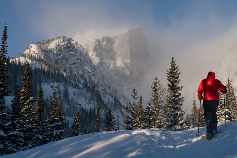 person snowshoeing in rocky mountain national park