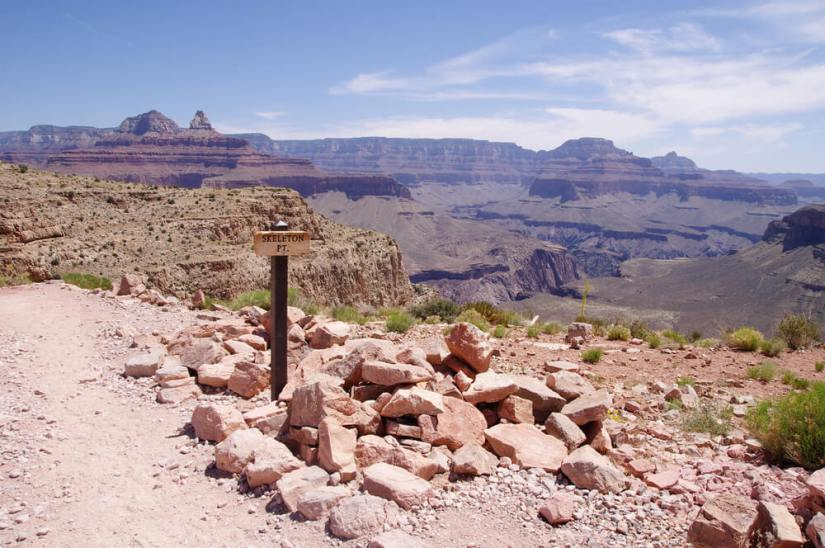 a sign reading skeleton point halfway down into the grand canyon with expansive views of the canyon everywhere you look