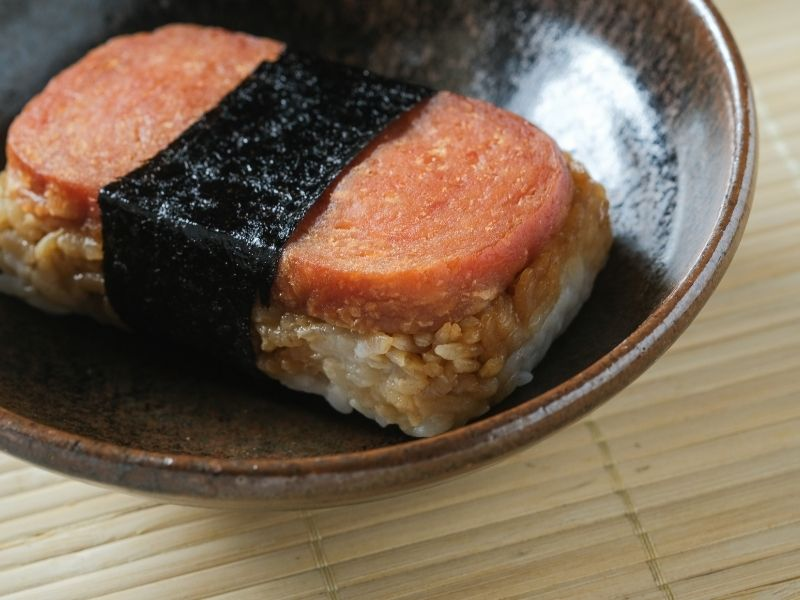 a piece of spam musubi in a plate