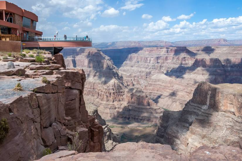 a skywalk deck at the grand canyon west rim, looking over canyon views below
