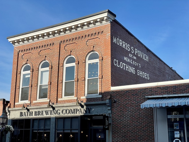 sign for bath brewing company in a brick building in downtown bath maine