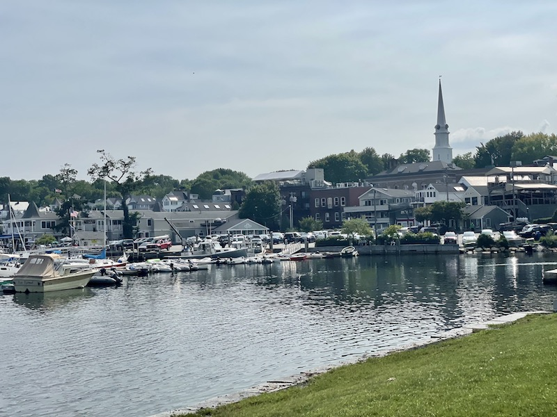 boats on the harbor on a hazy summer day in camden maine