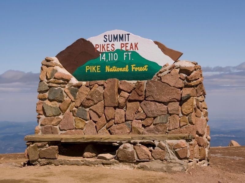 rock sign at the pike peak summit at over 14000 feet in colorado