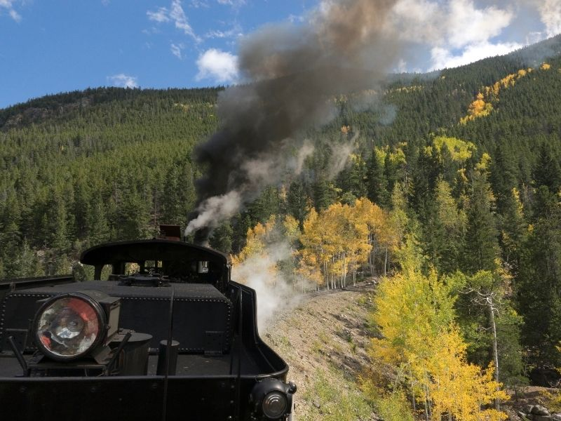 taking the georgetown loop railway with yellow aspens and evergreen trees