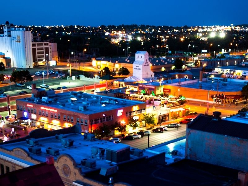 the lights of Rapid City after dark in downtown