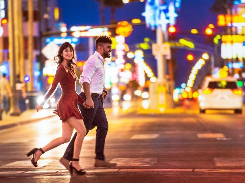 african american man and caucasian woman in heels going out for a night of dancing in las vegas