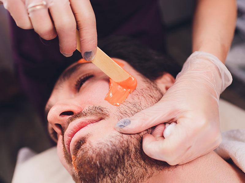 Man Receiving Face Waxing